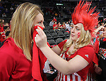 SIOUX FALLS, SD - MARCH 8:  Mackenzie Huber of the Coyote Crazies applies a paw print to the face of Sydney Petersen prior to the women's championship game between South Dakota and South Dakota State at the 2016 Summit League Tournament at the Denny Sanford Premier Center in Sioux Falls, S.D. (Photo by Dick Carlson/Inertia)
