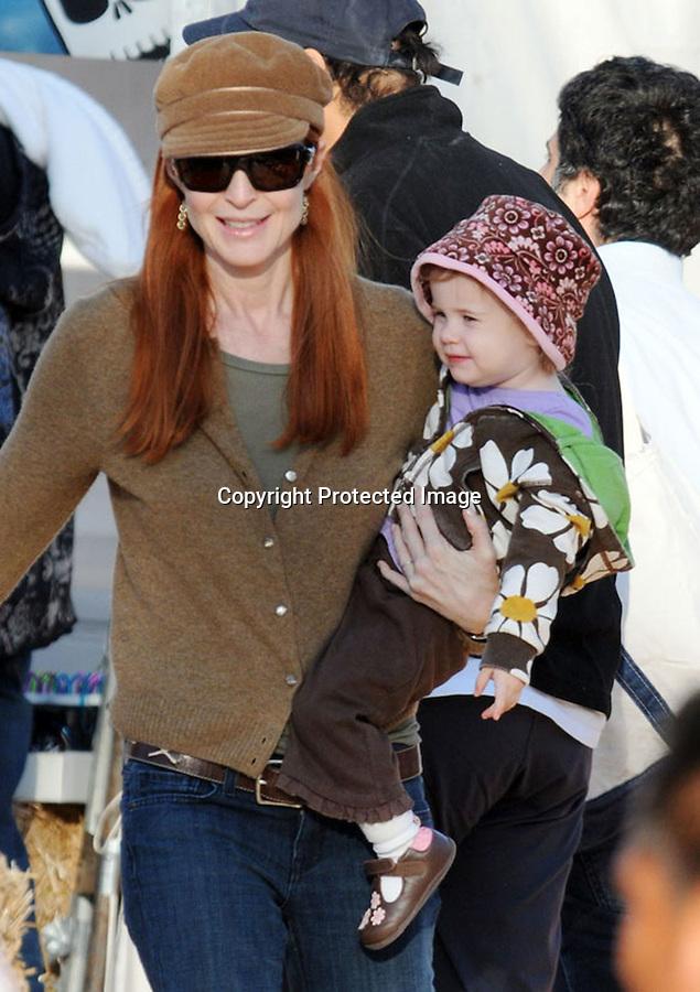 10-12-08 .Marcia Cross at Mr. Bones Pumpkin patch in Hollywood her kid buying pumpkins....AbilityFilms@yahoo.com.805-427-3519.www.AbilityFilms.com.