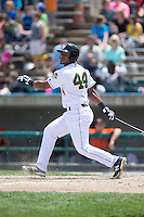 Juan De La Cruz (44) of the Lynchburg Hillcats follows through on his swing against the Frederick Keys at Calvin Falwell Field at Lynchburg City Stadium on May 14, 2015 in Lynchburg, Virginia.  The Hillcats defeated the Keys 6-3.  (Brian Westerholt/Four Seam Images)