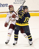 Isaac MacLeod (BC - 7), Justin Mansfield (Merrimack - 27) - The Boston College Eagles defeated the Merrimack College Warriors 4-2 to give Head Coach Jerry York his 900th collegiate win on Friday, February 17, 2012, at Kelley Rink at Conte Forum in Chestnut Hill, Massachusetts.