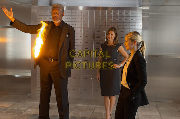 MORGAN FREEMAN, JESSICA LINDSEY and MELANIE LAURENT <br /> in Now You See Me (2013) <br /> *Filmstill - Editorial Use Only*<br /> CAP/NFS<br /> Image supplied by Capital Pictures