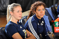 11 September 2011:  FIU Assistant Coach Ines Medved (left) and Student Assistant Coach Natalia Valentin (right) watch as Florida A&M's team warms up prior to the match.  The FIU Golden Panthers defeated the Florida A&M University Rattlers, 3-0 (25-10, 25-23, 26-24), at U.S Century Bank Arena in Miami, Florida.