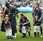 7 April 2007: Colorado players (l to r) Bouna Coundoul, Terry Cooke, and Brandon Prideaux try to help the local youngsters who came out with them for pregame ceremonies to stay warm. The Colorado Rapids defeated DC United 2-1 at Dick's Sporting Goods Park in Denver, Colorado in the opening game of the MLS regular season.