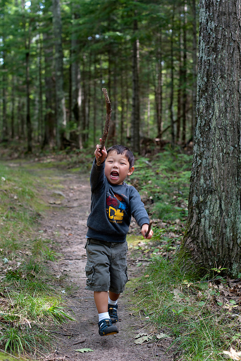 Holden Miller, 3, runs along a forest trail near Boulder Junction, Wis., on Aug. 7, 2010. The photo was made during a summer vacation with the Stute family while staying in a rented cottage in Wisconsin's Northwoods.