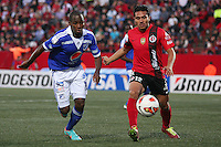 TIJUANA -MÉXICO, 10-04-2013. Noe Maya (d) del Tijuana y Dhawlin Leudo (i) de Millonarios durante el juego de la fase de grupos de la Copa Libertadores 2013 en el Estadio Caliente en Tijuana, Mexico./  Noe Maya (r) of Tijuana and  Dhawlin Leudo (l) of Millonarios fights for tha ball during match of the groups stage of Libertadores Cup 2013 at Caliente stadium in Tijuana, Mexico.  Photo: Gonzalo Gonzalez/JAM MEDIA/VizzorImage