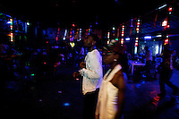 frequenters of the Shrine, a famous nightclub home of Fela Kuti's son Femi, dance  in Nigeria's capital Lagos on Monday March 30 2009..The club was home to the king of Afrobeat, Fela Anikulapo Kuti, who died in 1997 from Aids-related reasons..For more than two decades Fela performed at the shrine with the same incredible energy with which he enjoyed drugs and women..The shrine - then a dingy club on the outskirts of Lagos that became a legend - closed soon after Fela's death.