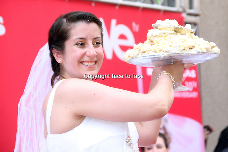 NEW YORK, NY - MAY 30: Winner Jennifer Paoliotti at WE tv's 10th Anniversary and Final Season of Bridezillas with Cake Eating Competition at the plaza at Madison Square Garden in New York City. May 30, 2013. Credit: RW/MediaPunch Inc.<br /> Credit: MediaPunch/face to face<br /> - Germany, Austria, Switzerland, Eastern Europe, Australia, UK, USA, Taiwan, Singapore, China, Malaysia, Thailand, Sweden, Estonia, Latvia and Lithuania rights only -