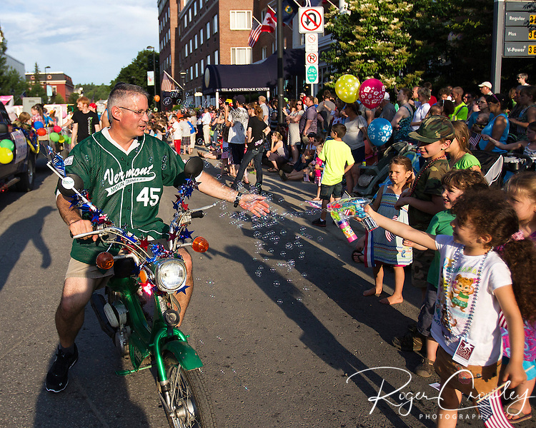Vermont Mountaineer Manager Joe Brown is greeted with bubbles as kids wave to him in the July 3rd Parade in Montpelier Vermont 2013.