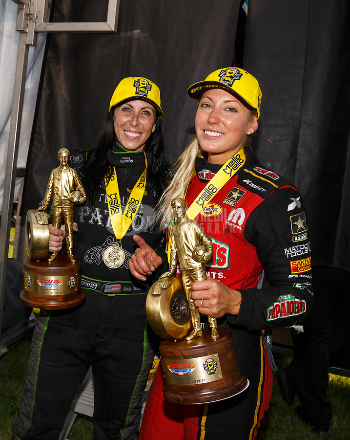 Aug 20, 2017; Brainerd, MN, USA; NHRA top fuel driver Leah Pritchett (right) and funny car driver Alexis DeJoria celebrate after becoming the first women to sweep the nitro classes at an NHRA event during the Lucas Oil Nationals at Brainerd International Raceway. Mandatory Credit: Mark J. Rebilas-USA TODAY Sports