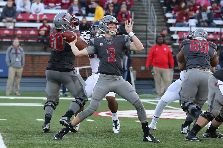 Tyler Hilinski, Washington State quarterback, fires a pass down the field during the Cougars Pac-12 Conference demolition of the Arizona Wildcats, 69-7, on November 5, 2016, at Martin Stadium in Pullman, Washington.