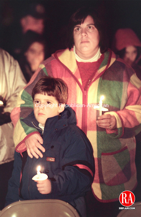 WATERTOWN,CT-11/15/98-1115CK05.tif-Kim Troost and her son Jacob of Watertown stand in the cold holding their candles during a candlelight vigil to remember victoms  of hate crimes infront of the First Congreational church in Watertown on Sunday.    CASEY KEIL PHOTO.