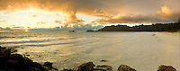 A golden sunrise brightens the windward shores of Bellow's and Waimanola Beaches.  This panoramic view includes Makapuu Point and Rabbit Island in the distance.