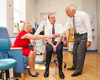 17 May 2016 - London, England - Prince William Duke of Cambridge (centre) and Ralph Lauren (right) meet breast cancer patient Kathryn England during a visit to the Royal Marsden NHS Foundation Trust, in Chelsea, west London, as he marks the opening of the hospital's new centre for breast cancer research named after the fashion designer. The Ralph Lauren Centre for Breast Cancer Research was funded by supporters of the Royal Marsden Cancer Charity, including a generous donation from the designer. William has a long association with the hospital, he became the Royal Marsden's president in 2007, following in the footsteps of his mother Diana, Princess of Wales, who held the same position from 1989 until her death in 1997. Photo Credit: ALPR/AdMedia
