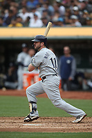 OAKLAND, CA - AUGUST 1:  Mike Moustakas #11 of the Milwaukee Brewers bats against the Oakland Athletics during the game at the Oakland Coliseum on Thursday, August 1, 2019 in Oakland, California. (Photo by Brad Mangin)