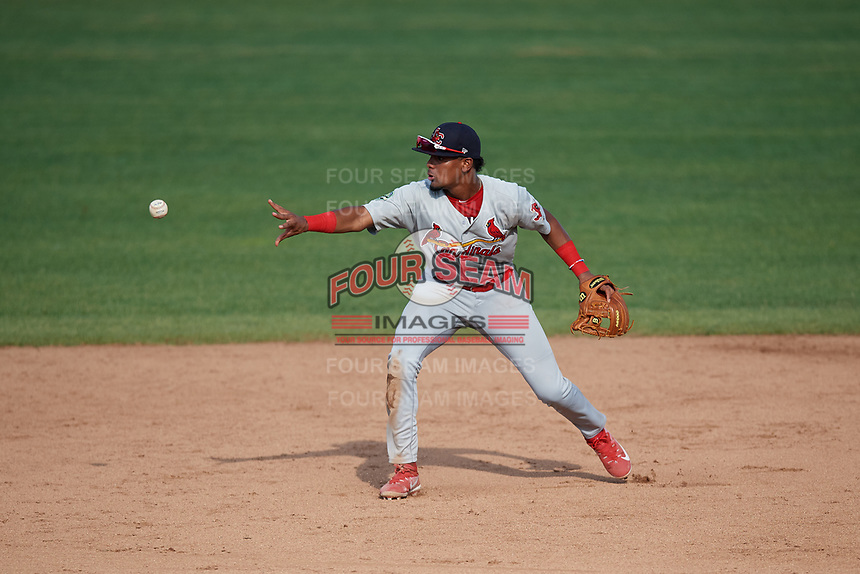 Johnson City Cardinals second baseman Moises Castillo (7) flips to shortstop Michael Perri (not pictured) covering the base during the first game of a doubleheader against the Princeton Rays on August 17, 2018 at Hunnicutt Field in Princeton, Virginia.  Johnson City defeated Princeton 6-4.  (Mike Janes/Four Seam Images)