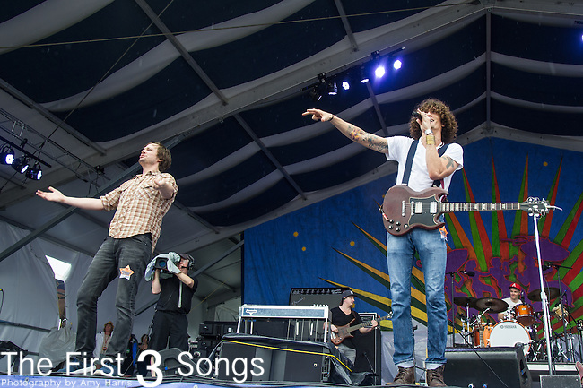 Ed Williams and David Shaw of The Revivalists performs during the 2015 New Orleans Jazz & Heritage Festival in New Orleans, Louisiana.