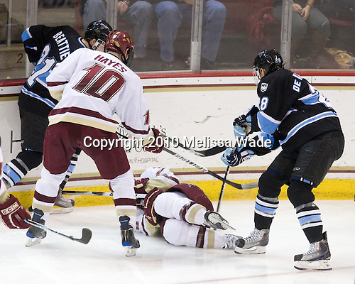 Kyle Beattie (Maine - 21), Jimmy Hayes (BC - 10), Tommy Cross (BC - 4), David deKastrozza (Maine - 28) - The Boston College Eagles defeated the University of Maine Black Bears 6-1 on Friday, January 15, 2010, at Conte Forum in Chestnut Hill, Massachusetts.