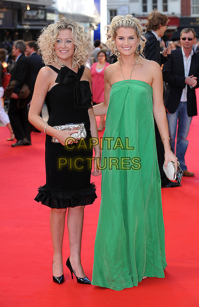 "HELEN NOBLE & SARAH JAYNE DUNN .at ""The Dark Knight"" UK Film Premiere, Odeon Leicester Square, London, England, 21st July 2008..Batman movie full length black dress clutch bag green halterneck maxi Hollyoaks.CAP/BEL.©Tom Belcher/Capital Pictures"