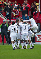 25 April 2010: Toronto FC players celebrate a goal by Toronto FC midfielder Dwayne De Rosario #14 during a game between the Seattle Sounders and Toronto FC at BMO Field in Toronto..Toronto FC won 2-0....