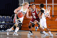 9 January 2010:  FIU's Monika Bosilj (13) drives to the basket with Troy's Brittnie Davis (3) defending in the first half as the Troy Trojans defeated the FIU Golden Panthers, 61-59, at the U.S. Century Bank Arena in Miami, Florida.