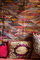 Morocco.  Living Room Pillows and Wall hanging in a House at Ait Benhaddou Ksar, a World Heritage Site.