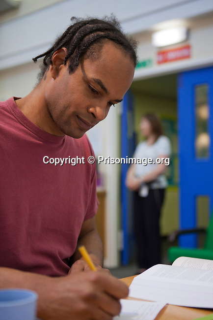 A prisoner studying in the prison library. HMP The Mount, Hemel Hampstead, United Kingdom.