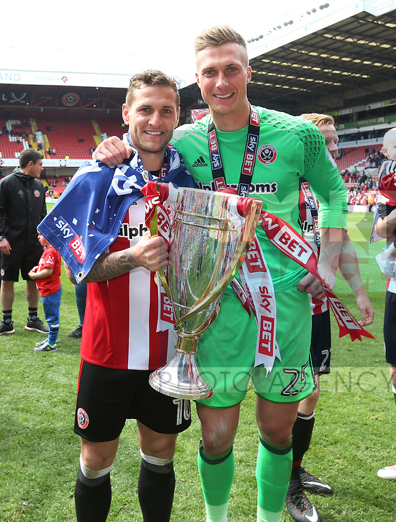 Sheffield United's Billy Sharp and Simon Moore celebrate with the trophy during the League One match at Bramall Lane, Sheffield. Picture date: April 30th, 2017. Pic David Klein/Sportimage