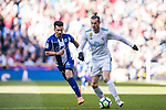 Gareth Bale (R) of Real Madrid is tackled by Hernan Arsenio Perez of Deportivo Alaves during the La Liga 2017-18 match between Real Madrid and Deportivo Alaves at Santiago Bernabeu Stadium on February 24 2018 in Madrid, Spain. Photo by Diego Souto / Power Sport Images