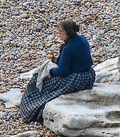 BNPS.co.uk (01202 558833)<br /> Pic: Graham Hunt/BNPS<br /> <br /> Lights, camera...Pastie - Kate Winslet filming a scene on the Beach at Eype near Bridport in Dorset yesterday for the new film Ammonite about the life of fossil hunter Mary Anning.<br /> <br /> Kate Winslet sharing a joke with a member of the film crew between scenes.
