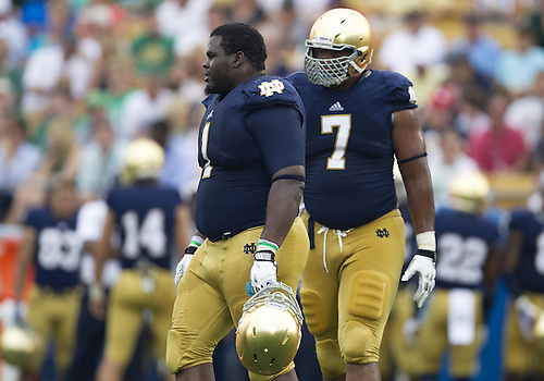 August 31, 2013:  Notre Dame defensive linemen Louis Nix III (1) and Stephon Tuitt (7) during NCAA Football game action between the Notre Dame Fighting Irish and the Temple Owls at Notre Dame Stadium in South Bend, Indiana.  Notre Dame defeated Temple 28-6.