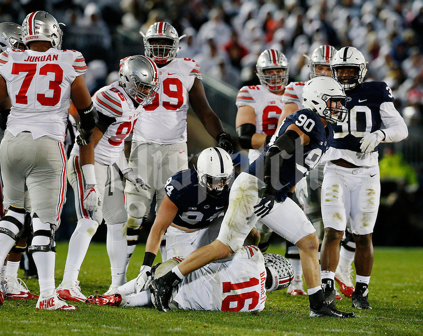 Penn State Nittany Lions defensive end Garrett Sickels (90) celebrates after bringing down Ohio State Buckeyes quarterback J.T. Barrett (16) during the third quarter of a NCAA Division I college football game between the Ohio State Buckeyes and the Penn State Nittany Lions on Saturday, October 22, 2016 at Beaver Stadium in State College, Pennsylvania. (Joshua A. Bickel/The Columbus Dispatch)
