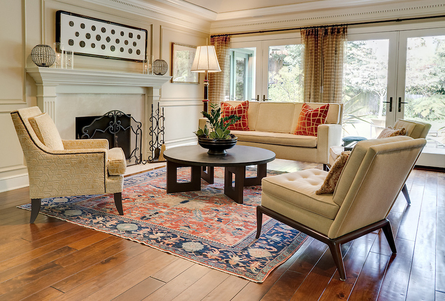 formal living room with hardwood floors and afghan