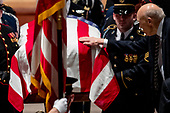 Former Sen. Alan Simpson, R-Wyo, touches the flag-draped casket of former President George H.W. Bush as it is carried out by a military honor guard during a State Funeral at the National Cathedral, Wednesday, Dec. 5, 2018, in Washington. <br /> Credit: Andrew Harnik / Pool via CNP