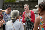 Harriett Olson (in red sweater), the chief executive officer of United Methodist Women, sings and dances with a group of children and their parents in the Manila North Cemetery in Manila, Philippines, on January 16, 2018. Olson was in the Philippines to meet with women from throughout the region. United Methodist Women has long supported educational and other work in the cemetery carried out by the Kapatiran-Kaunlaran Foundation (KKFI).