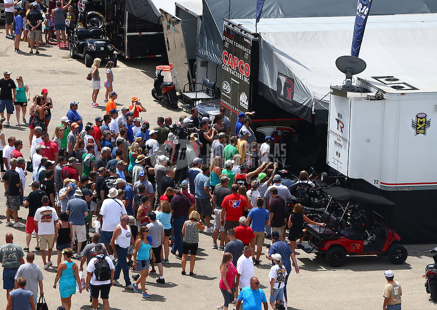 Jul 10, 2016; Joliet, IL, USA; Fans in the pit area of NHRA top fuel driver Steve Torrence as he warms up his engine during the Route 66 Nationals at Route 66 Raceway. Mandatory Credit: Mark J. Rebilas-USA TODAY Sports
