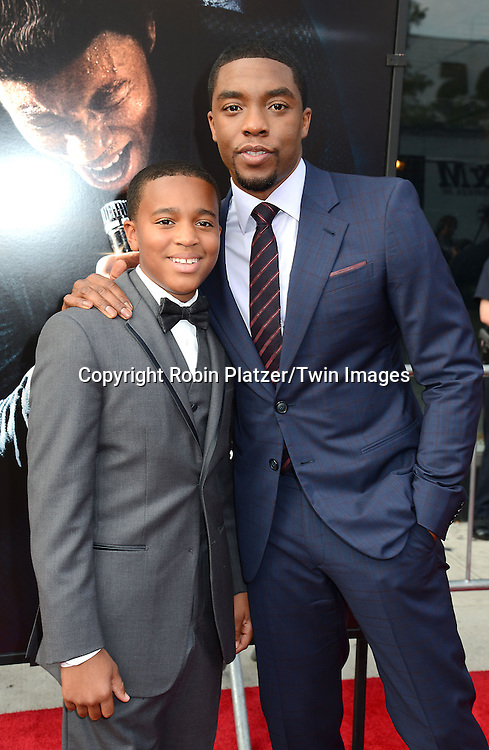 "Jordan Scott and Chadwick Boseman attends the World Premiere of ""Get On Up"" at the Apollo Theater in Harlem in New York Citiy on July 21, 2014."