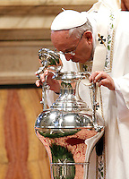 Papa Francesco celebra la Santa Messa del Crisma nella Basilica di San Pietro, Citta' del Vaticano, 2 aprile 2015.<br /> Pope Francis blows inside an amphora containing holy oil during a Chrism Mass in St. Peter's Basilica at the Vatican, 2 April 2015.<br /> UPDATE IMAGES PRESS/Isabella Bonotto<br /> <br /> STRICTLY ONLY FOR EDITORIAL USE