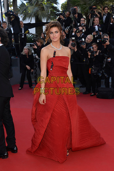 Allison Williams.'Blood Ties' premiere at the 66th  Cannes Film Festival, France..20th May 2013.full length red strapless dress folds twisted black stick baton folds .CAP/PL.©Phil Loftus/Capital Pictures.
