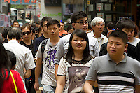 HONG KONG, MAY 08: A crowd of pedestrians crosses the street in Mong Kok neighborhood, on May 8, 2015, in Hong Kong. (Photo by Lucas Schifres/Pictobank)