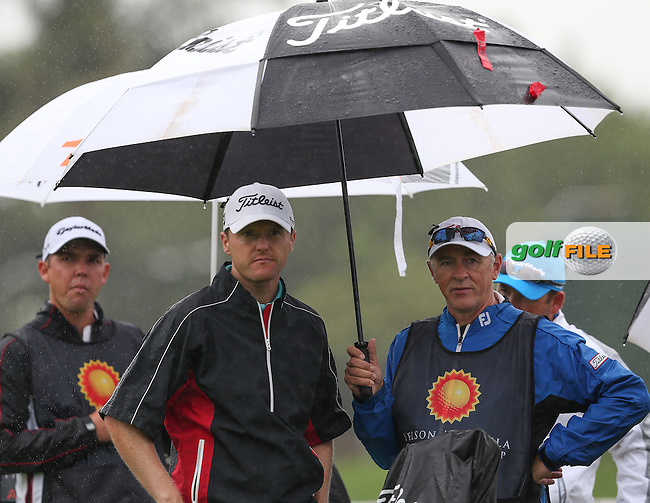 Michael Hoey (NIR) shelters from the wet and windy weather during Round One of The Nelson Mandela Championship 2013 presented by ISPS Handa, at the Mount Edgecombe Country Club, KwaZulu-Natal, South Africa. Picture:  David Lloyd / www.golffile.ie
