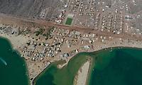 Aerial view of the community of Punta Chueca where the population of the Seri ethnic group lives. Punta Chueca, Socaaix in the Seri language, is a locality in the Mexican state of Sonora. It is located about 20 kilometers north of the town of Bahía de Kino being a port in the Gulf of California, Punta Chueca is the point of the mainland closest to Isla Tiburón, from which it is separated only by the Estrecho del Infiernillo.<br /> <br /> (Photo: Luis Gutierrez)<br /> Vista aérea de la comunidad de Punta Chueca donde vive la población de la etnia Seri.  Punta Chueca, Socaaix en idioma seri, es una localidad del estado mexicano de Sonora.  Se encuentra a unos 20 kilómetros al norte de la población de Bahía de Kino siendo un puerto en el Golfo de California, Punta Chueca es el punto de tierra firme más cercano a la Isla Tiburón, de la que la separa únicamente el Estrecho del Infiernillo.<br /> <br /> (Photo:Luis Gutierrez)