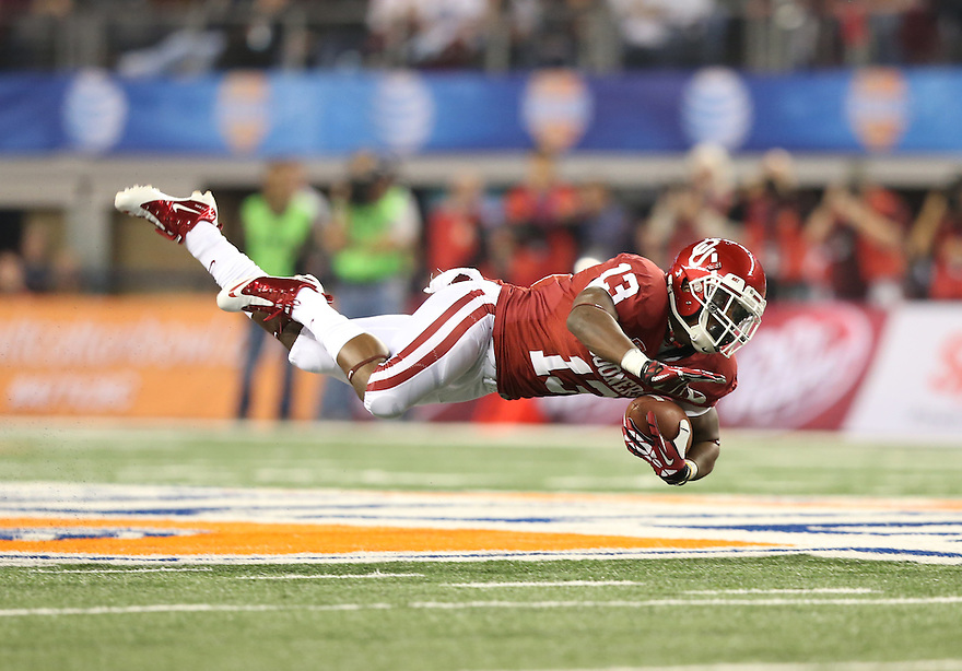 Jan 4, 2013; Arlington, TX, USA; Oklahoma Sooners wide receiver Mike Evans dives for exrta yardage against the Texas A&M Aggies during the Cotton Bowl at Cowboys Stadium.  Mandatory Credit: Tim Heitman-USA TODAY Sports