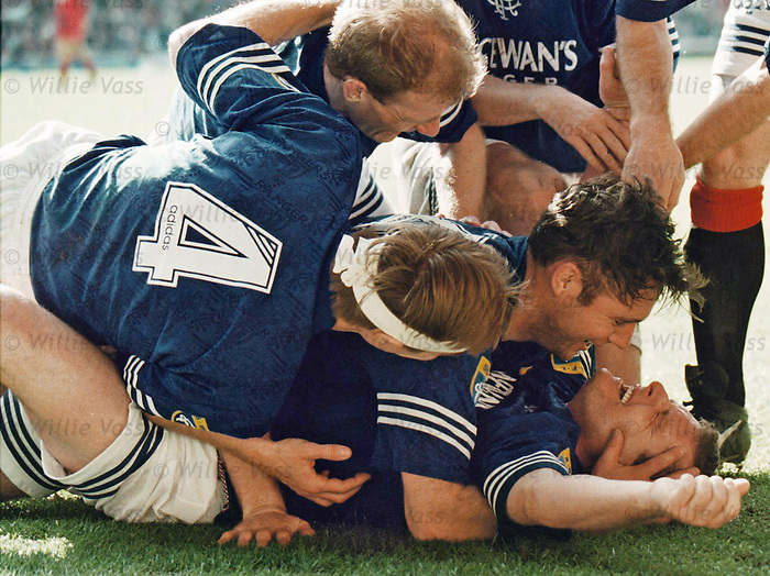Paul Gascoigne is kissed by Ally McCoist, Gordon Durie and Richard Gough as he seals the league title with a stunning hat-trick against Aberdeen at Ibrox