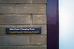 Connah's Quay Nomads 1 Llandudno 1, 20/09/2016. Deeside Stadium, Welsh Premier League. A bilingual sign outside the dressing rooms at the Deeside Stadium before Connah's Quay Nomads played Llandudno in a Welsh Premier League match. Both clubs represented Wales in the 2016-17 Europa League, the first time either had competed in European competition. The match ended in a 1-1 draw, watched by 181 spectators. Photo by Colin McPherson.