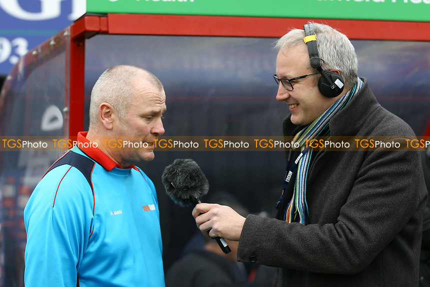 Woking manager Alan Dowson gets interviewed ahead of <br /> Woking vs Watford, Emirates FA Cup Football at The Laithwaite Community Stadium on 6th January 2019
