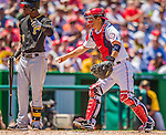 25 July 2013: Washington Nationals catcher Kurt Suzuki tags Starling Marte out at the plate during a game against the Pittsburgh Pirates at Nationals Park in Washington, DC. The Nationals salvaged the last game of their series, winning 9-7 ending their 6-game losing streak. Mandatory Credit: Ed Wolfstein Photo *** RAW (NEF) Image File Available ***
