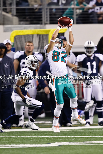 Miami Dolphins wide receiver Brian Hartline (82) and Dallas Cowboys cornerback Alan Ball (20) in action during the Thanksgiving Day game between the Miami Dolphins and the Dallas Cowboys at the Cowboys Stadium in Arlington, Texas. Dallas defeats Miami 20 to 19...