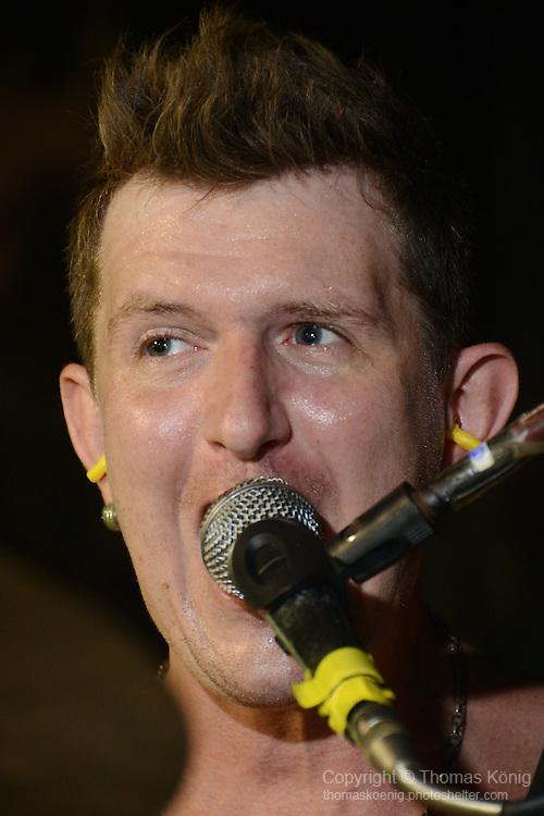 Kaohsiung, Taiwan -- Close-up of drummer Tim Hardwick of British Rock 'n' Roll band GOOBER GUN during a performance.
