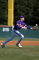 Stan Widman (6) of the Clemson Tigers can't corral this infield pop fly during the second game of a double header versus the Wake Forest Demon Deacons at Gene Hooks Stadium in Winston-Salem, NC, Sunday, March 9, 2008.