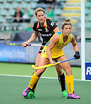The Hague, Netherlands, June 05: Kellie White #16 of Australia in action during the field hockey group match (Women - Group A) between Belgium and Australia on June 5, 2014 during the World Cup 2014 at Kyocera Stadium in The Hague, Netherlands. Final score 2:3 (1:1) (Photo by Dirk Markgraf / www.265-images.com) *** Local caption *** Kellie White #16 of Australia, Aline Fobe #4 of Belgium
